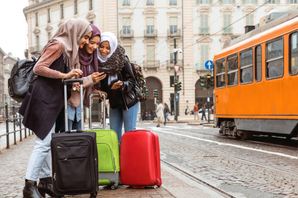 Arab tourist looking for the hotel during an holiday in Italy stock photo