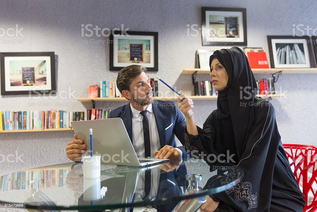 Arab Woman and an Expat in a Meeting stock photo