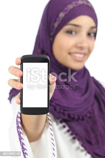 istock Arab woman displaying an app blank smart phone screen 461999249