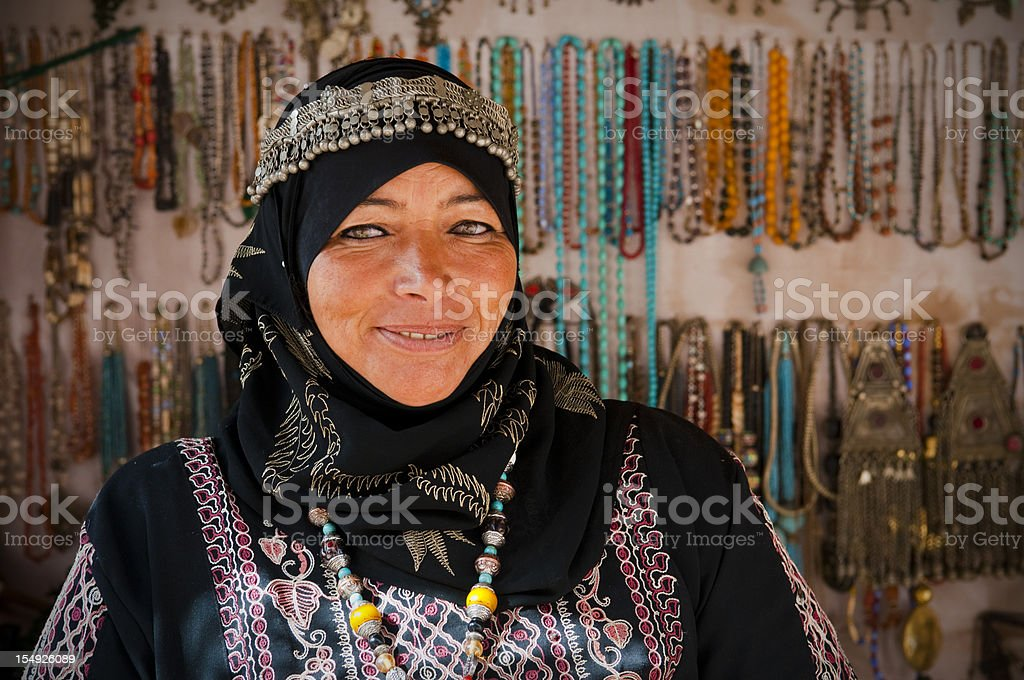 Arab woman inside her souvenir shop in Petra stock photo