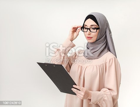 istock Arab woman teacher studio portrait 1061242810