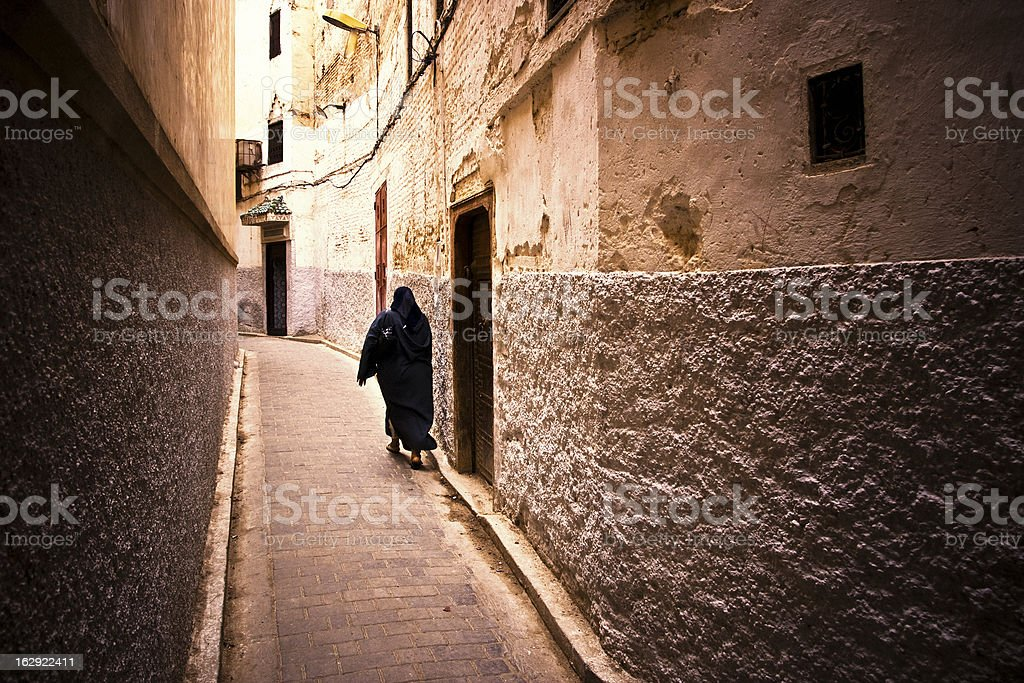 Arab Woman Walking in an Alley royalty-free stock photo