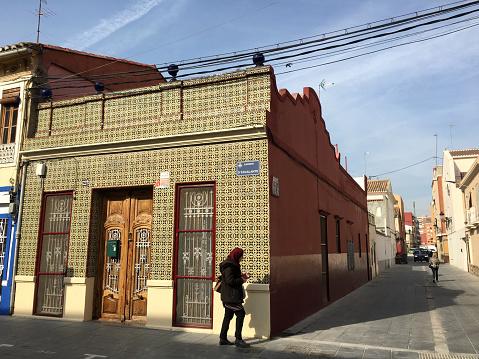 Arab woman walking in El Cabanyal district, Valencia, Spain