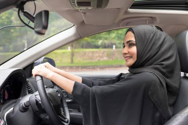 arab women driving car. - saudi woman stock photos and pictures