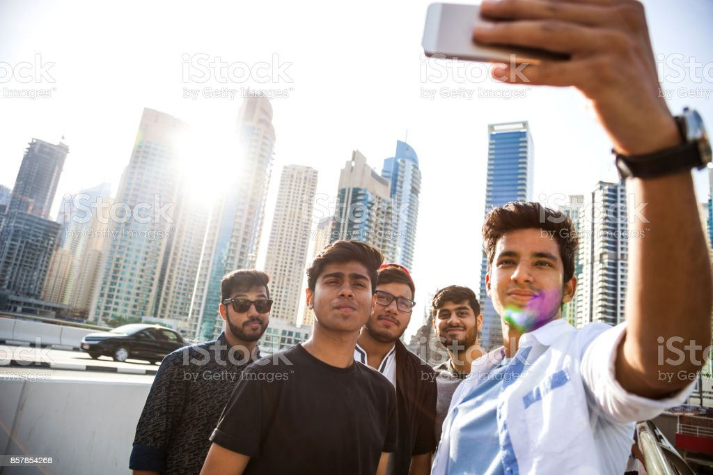 Arab Youth - Group of middle eastern male friends hanging out in Dubai stock photo
