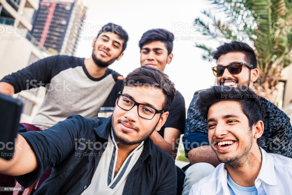 819ae18692b2 Arab Youth - Group of middle eastern male friends hanging out in Dubai  royalty-free