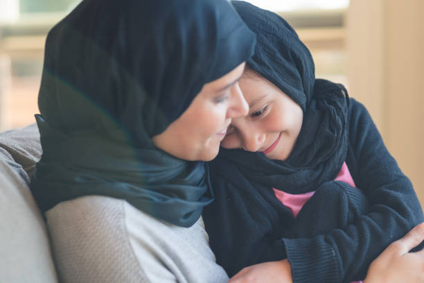 Arab-American Woman Holds Her Young Daughter stock photo