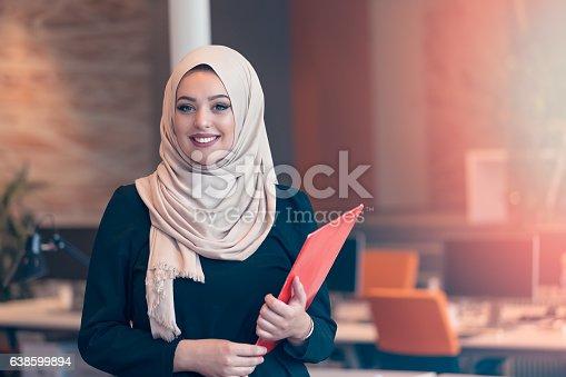 istock Arabian business woman holding a folder in modern startup office 638599894