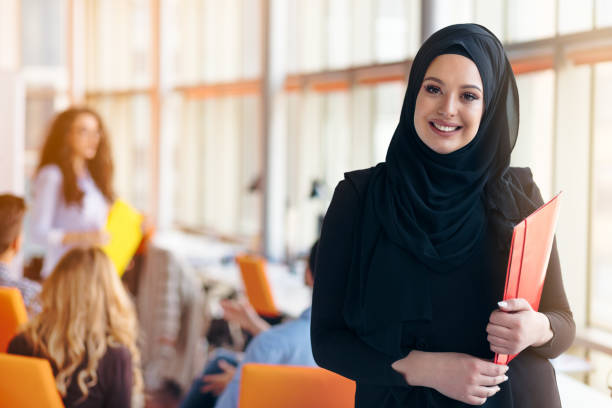 Arabian business woman with hijab holding a folder stock photo