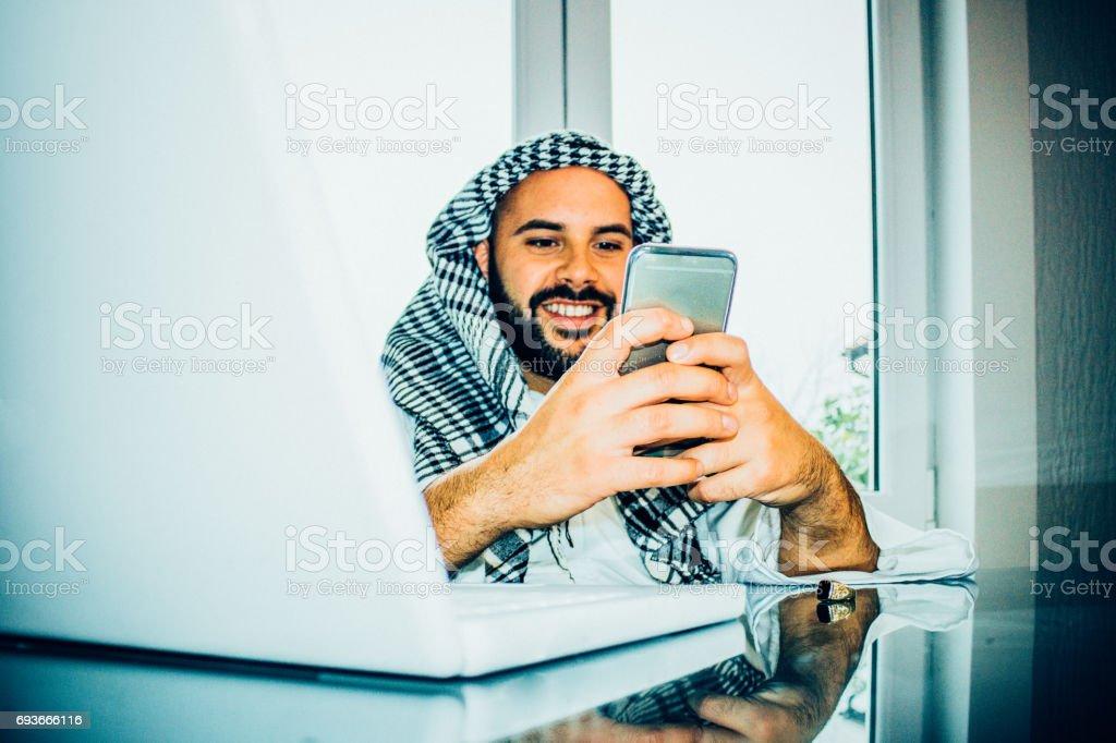 Arabian businessman on phone call stock photo