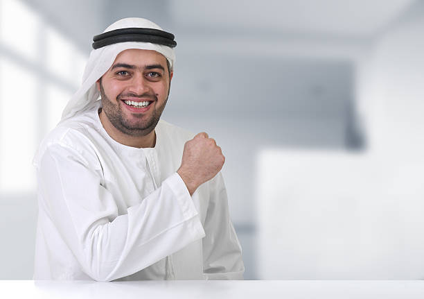 arabian businessman working in his office - kuwait currency stock photos and pictures