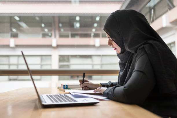 arabian businesswoman working in the room. - saudi woman stock photos and pictures