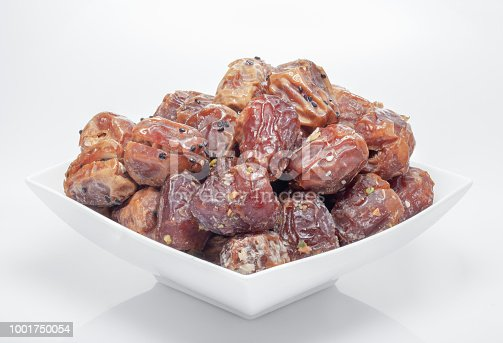 963384046 istock photo Arabian dates with nuts in white bowl 1001750054