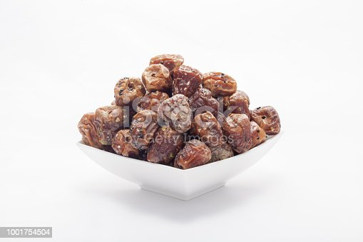 963384046 istock photo Arabian dates with nuts in white bowl 1001754504