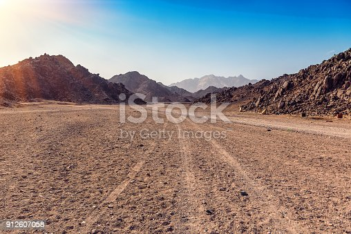 tracks from the car in Arabian desert in Egypt