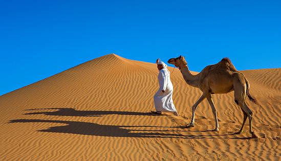 arab man walking in the desert