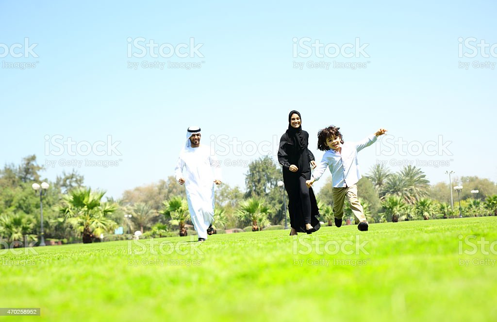Arabian family playing in the park. stock photo