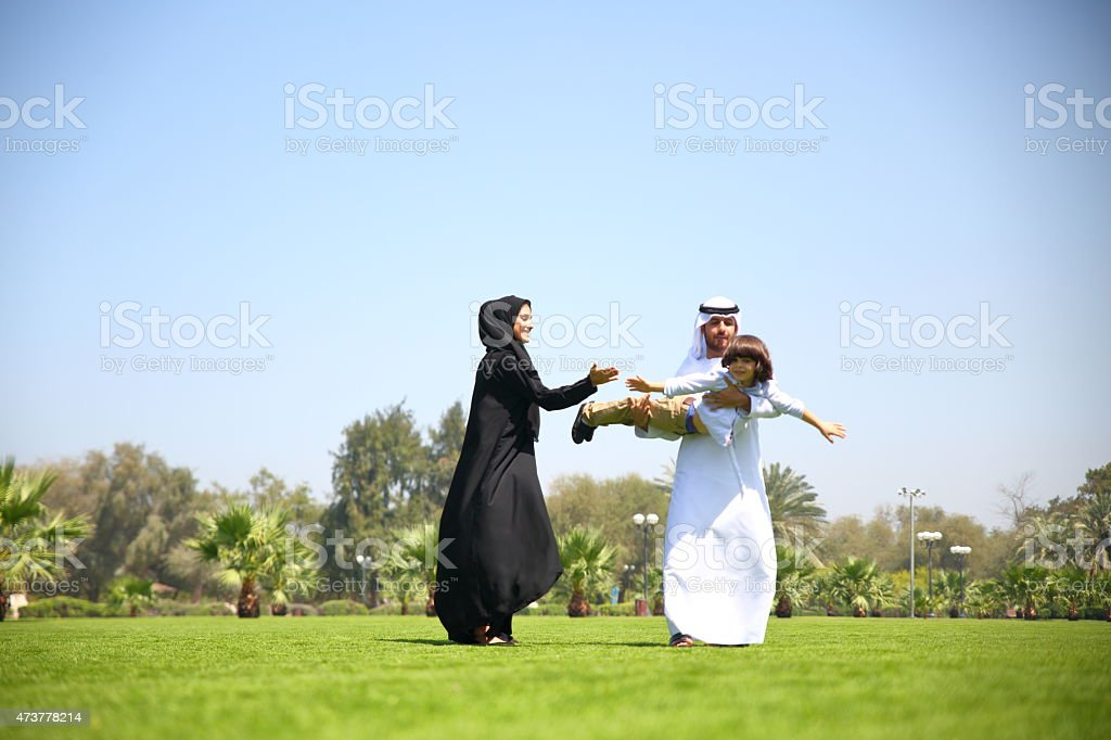 Arabian family playing in the park stock photo