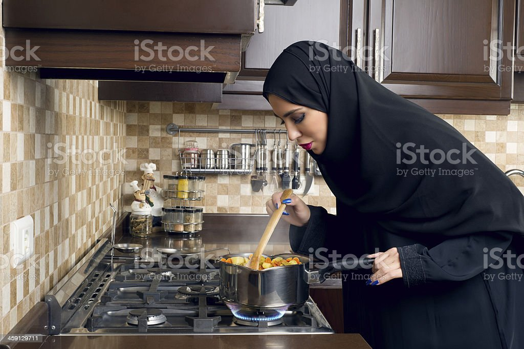 Arabian House Wife cooking in her kitchen stok fotoğrafı