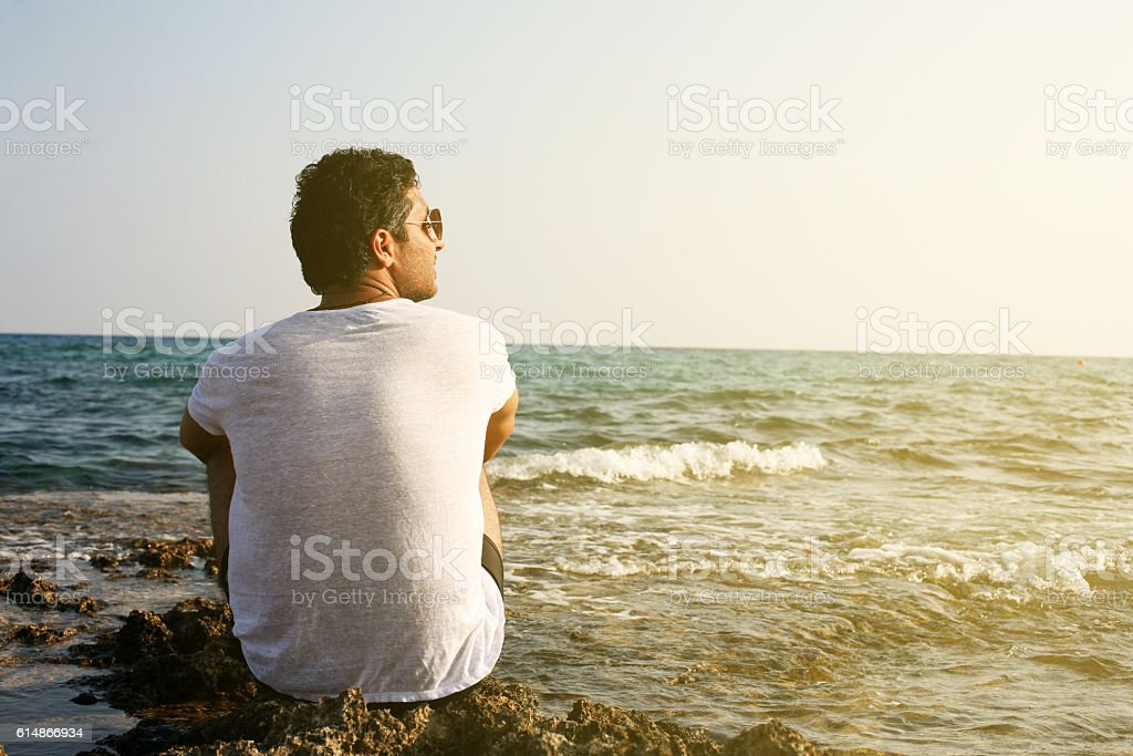 Arabian man on the beach. stock photo
