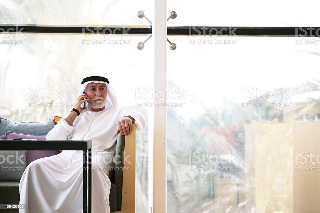 Arabian man talking on phone stock photo
