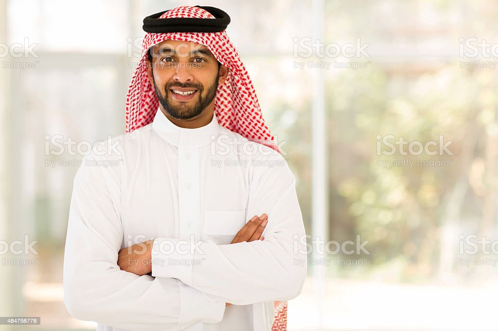 arabian man with arms crossed stock photo
