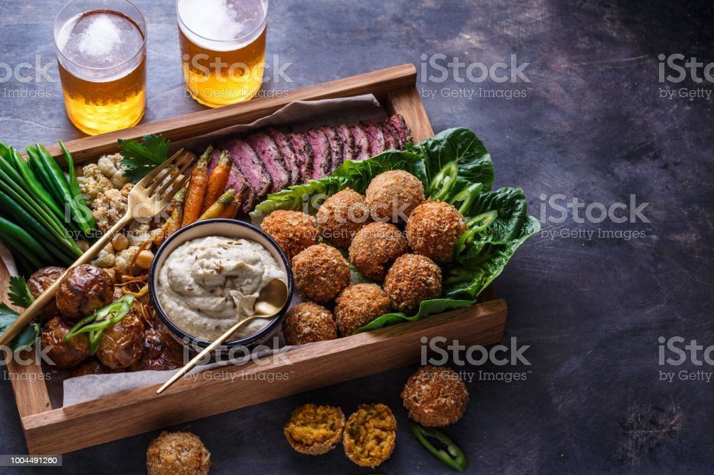 Arabian meze food falafel, beef, babaghanous, fried cauliflower, beans. stock photo