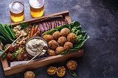 istock Arabian meze food falafel, beef, babaghanous, fried cauliflower, beans. 1179124892