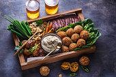 istock Arabian meze food falafel, beef, babaghanous, fried cauliflower, beans. 1179124924