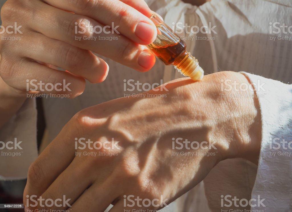 Arabian oud attar perfume or agarwood oil fragrances in crystal bottle. stock photo
