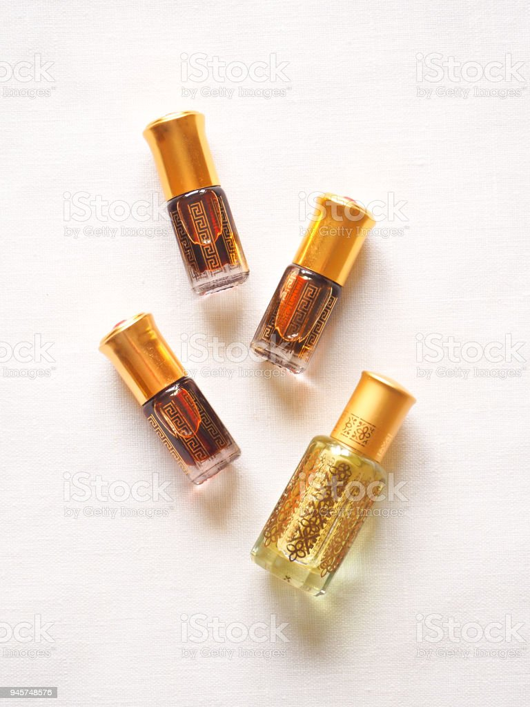 Arabian oud attar perfume or agarwood oil fragrances in mini bottles. stock photo