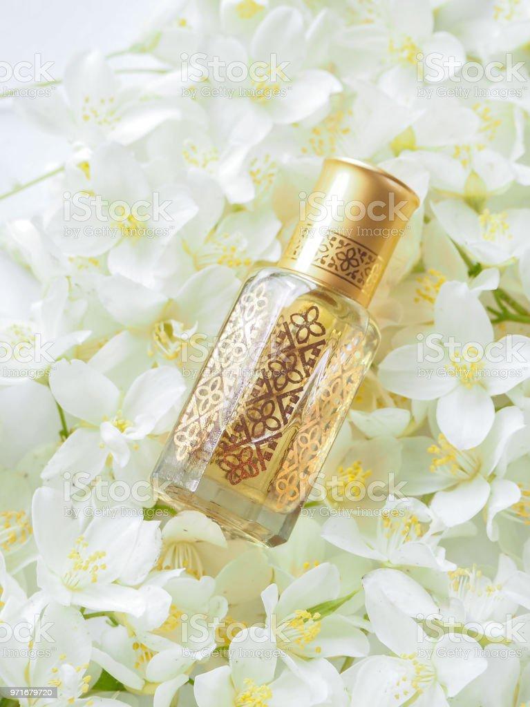 Arabian oudh attar perfume or agarwood oil fragrances with Jasmine in mini bottle. stock photo