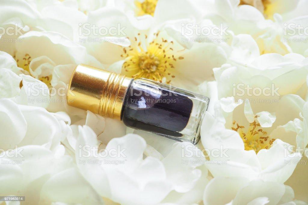 Arabian oudh attar perfume or agarwood oil fragrances with Rose in mini bottle. stock photo