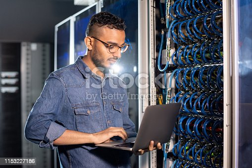 istock Arabian server engineer using laptop 1153227186