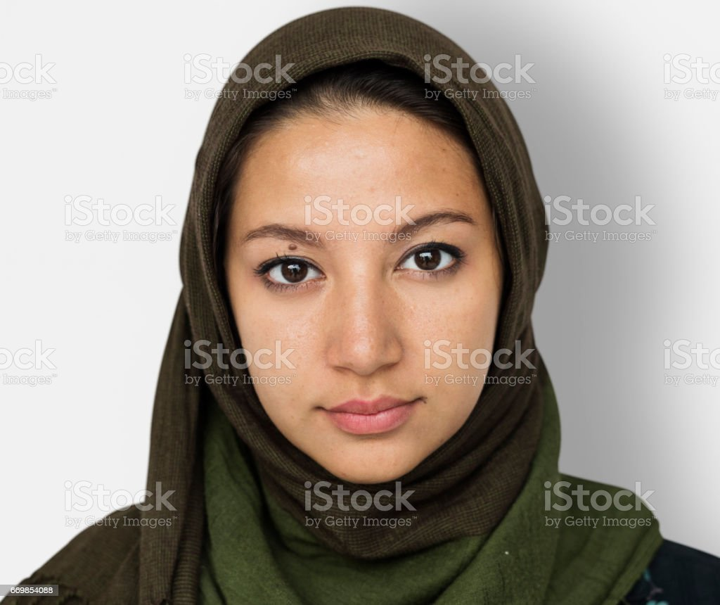 Arabian Woman Face Covered with Hijab Studio Portrait stock photo