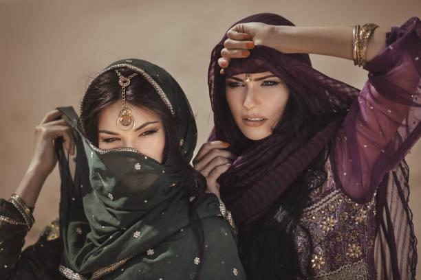 Arabian woman traveling in desert stock photo