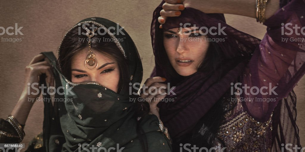 Arabian woman traveling in desert. Sandstorm effect not noise stock photo