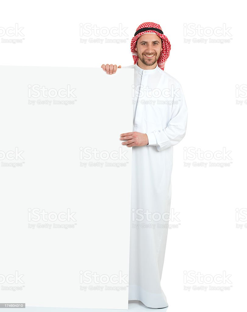 Arabian Young Adult Man and Blank Card royalty-free stock photo