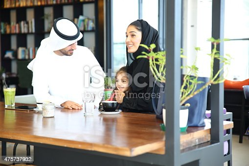 istock Arabian Young family sitting in cafe 475737932