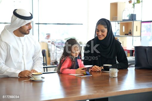istock Arabian Young family sitting in cafe 517269234