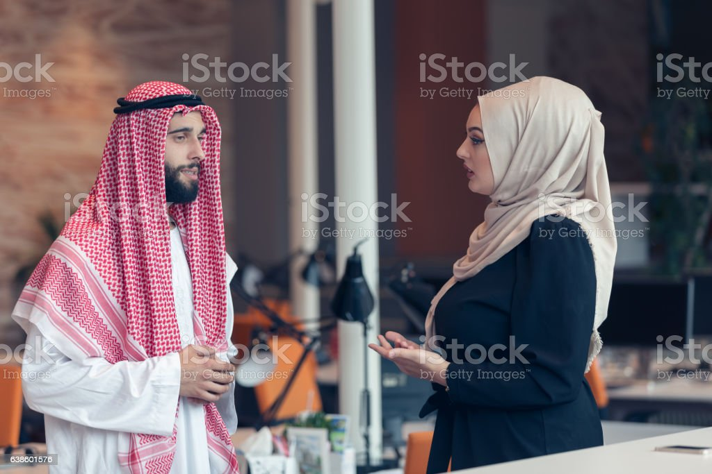 Arabic business couple working together on project stock photo
