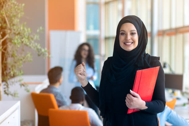 Arabic business woman working in team with her colleagues at office stock photo