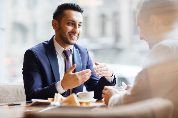 Arabic Businessman at Meeting in Cafe stock photo