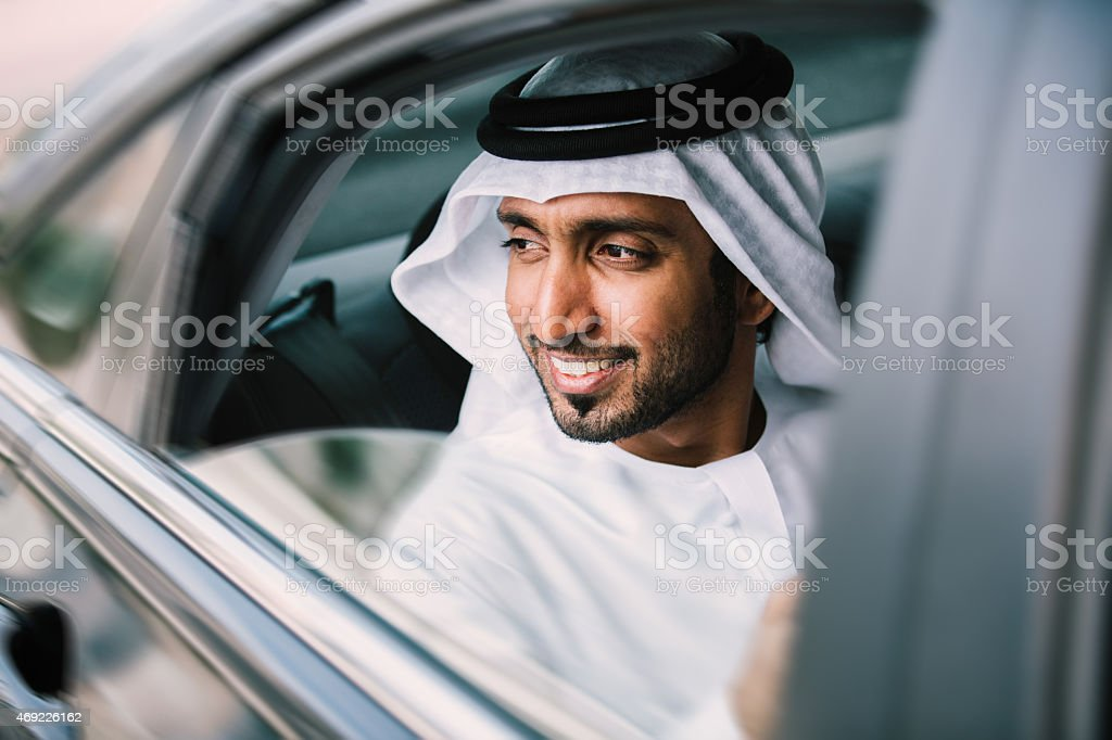 Arabic businessman in car stock photo