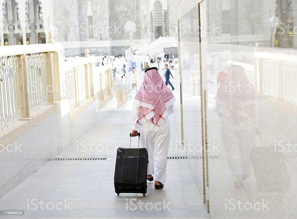 Arabic businessman walking stock photo