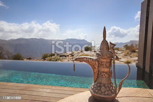 Modern meets tradition. Arabic coffee pot by the pool