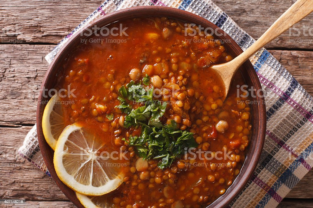 Arabic cuisine: Harira soup in a bowl close-up. horizontal stock photo
