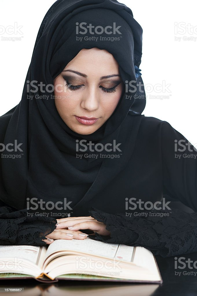 Arabic girl reading the Koran stock photo