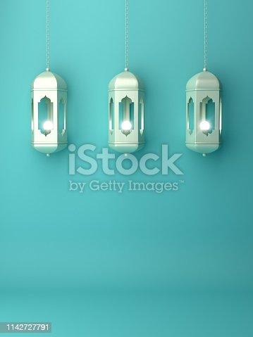 1142727715istockphoto Arabic hanging lantern on blue pastel background copy space text. 1142727791