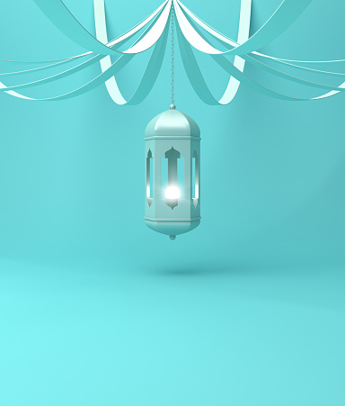 istock Arabic hanging lantern with ribbon on blue pastel background. 1142727788